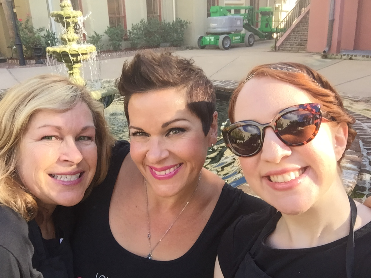 Sandy, Lou, and Alex selfie it up real quick before heading to their wedding!