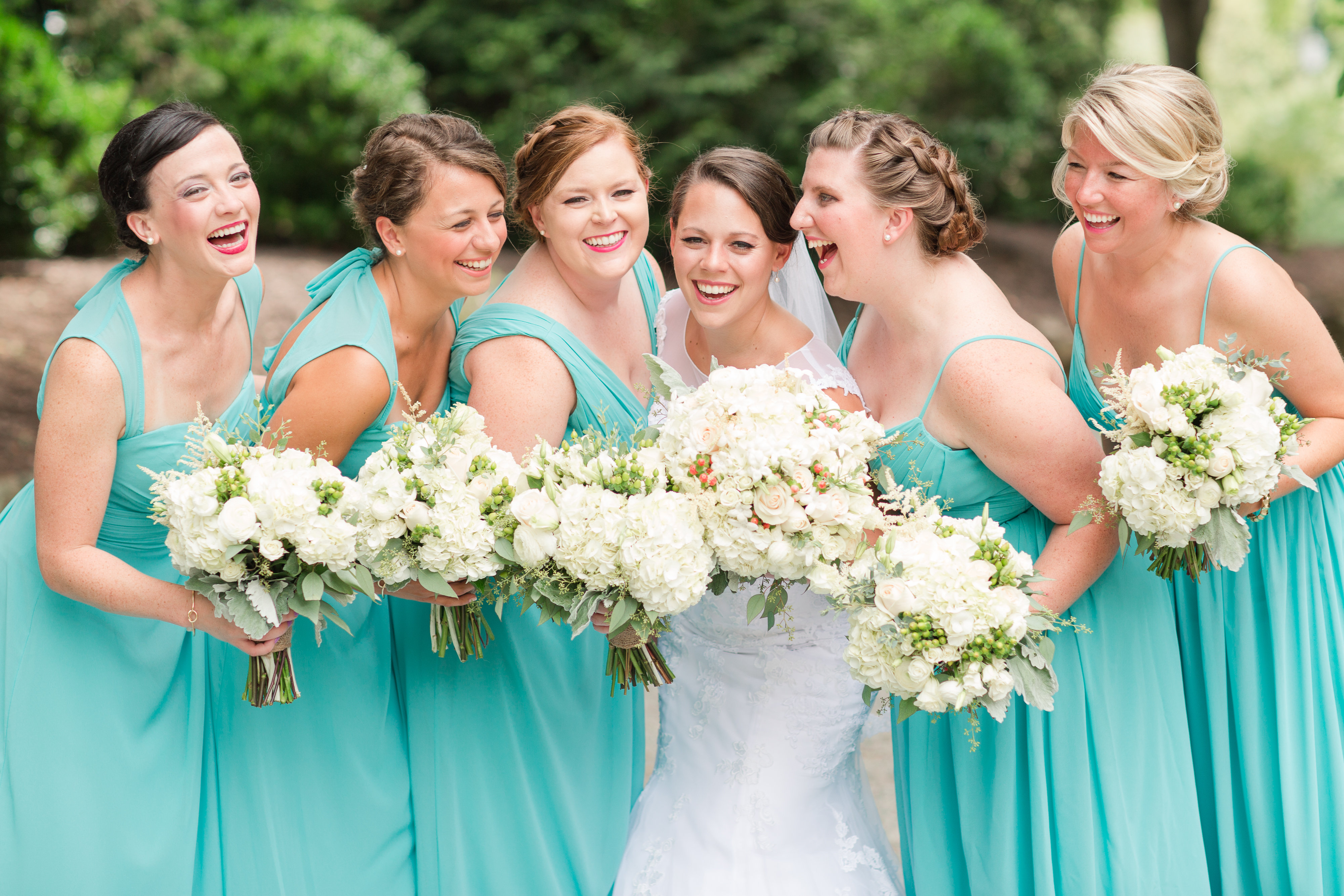 Lauren shares a happy moment with her bridesmaids