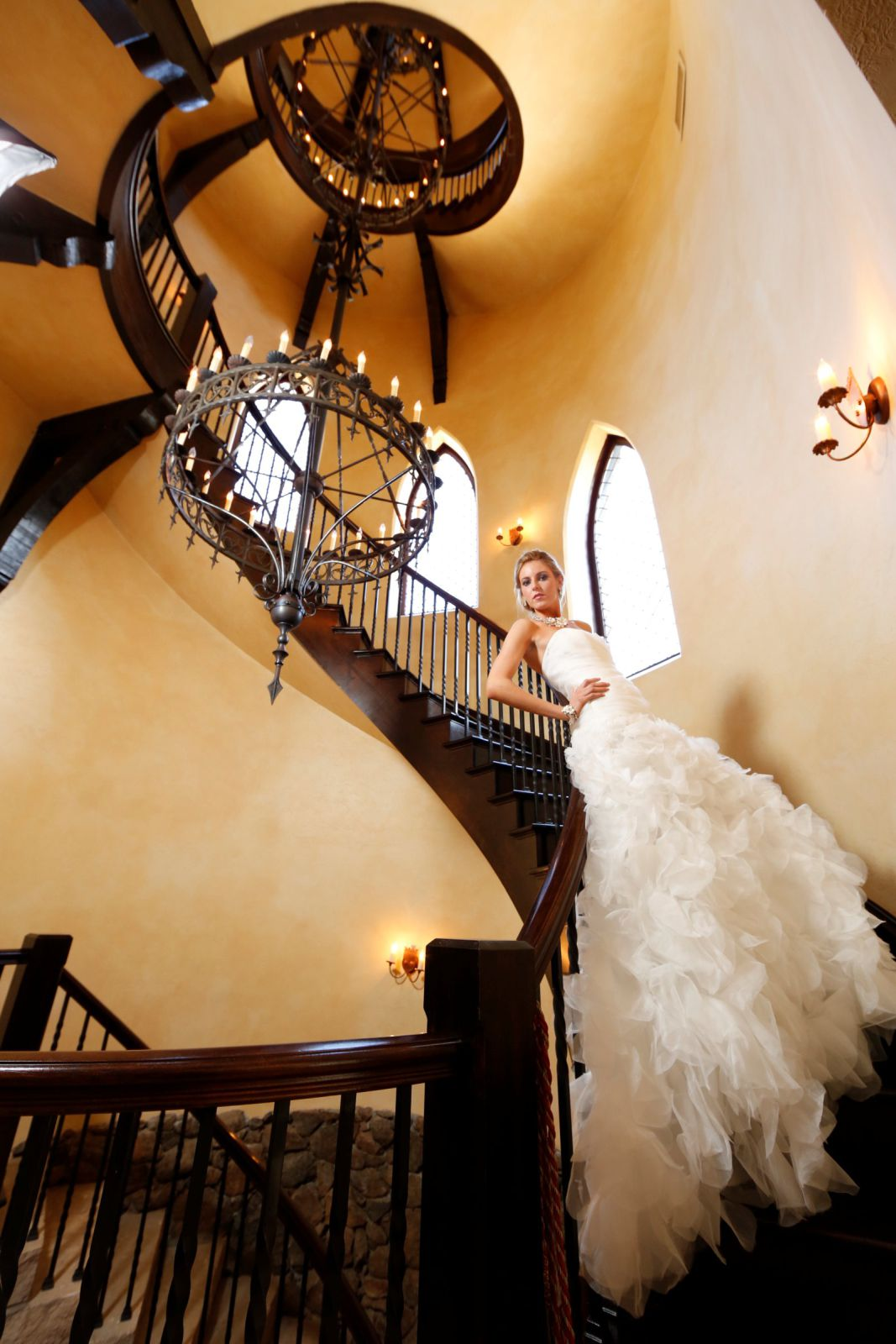bride posed on spiral staircase