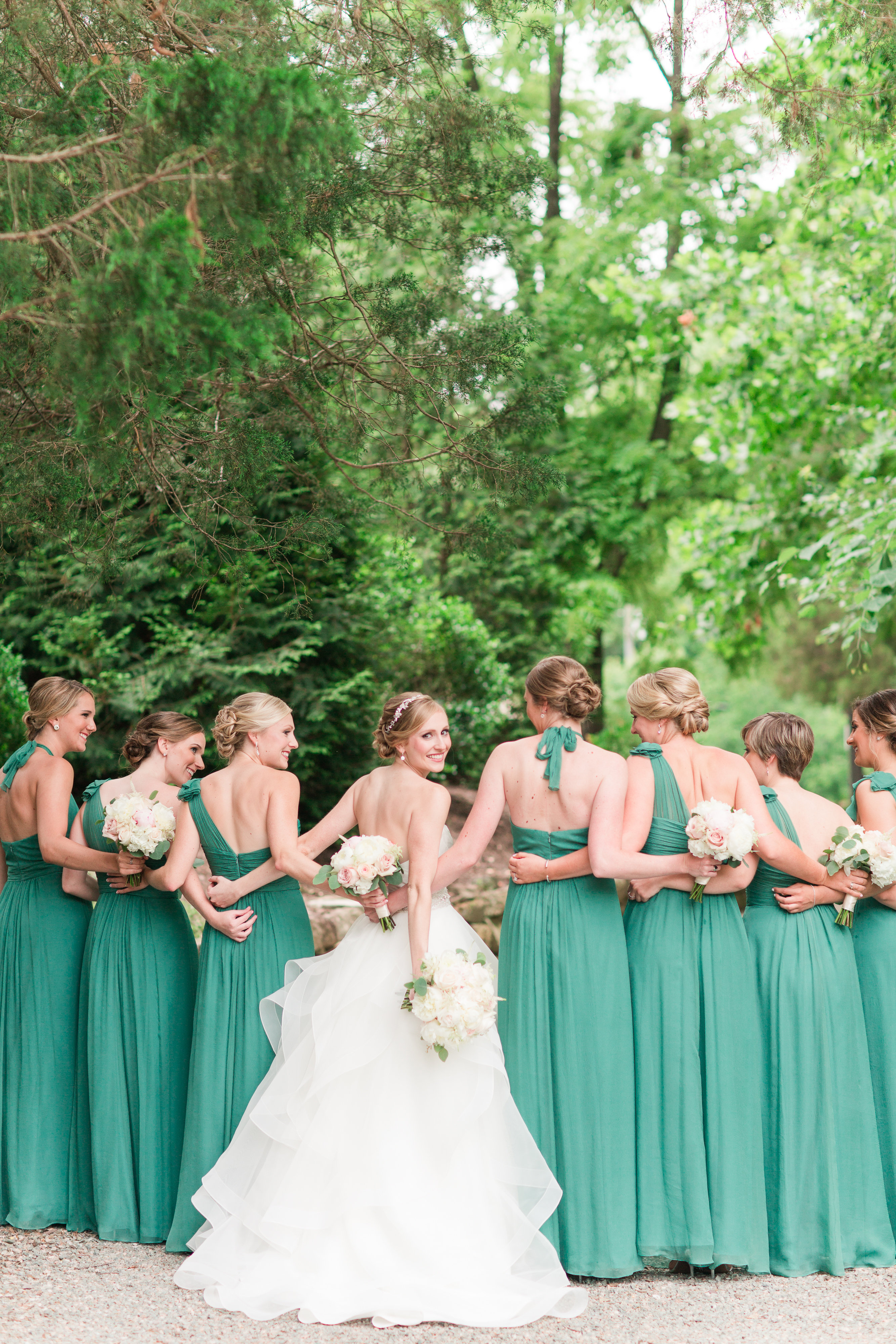 """All the bridesmaids are showing off the up-do's """"glammies,"""" Ashley and Tomeka created for them."""