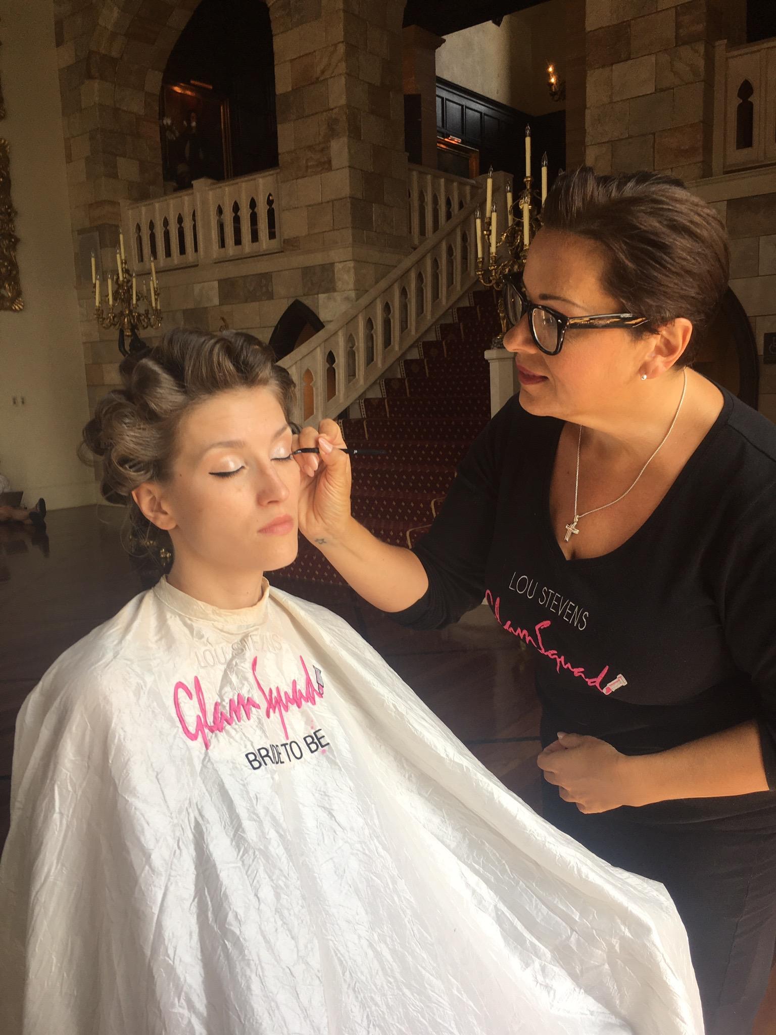 Lou applies Bashka's makeup