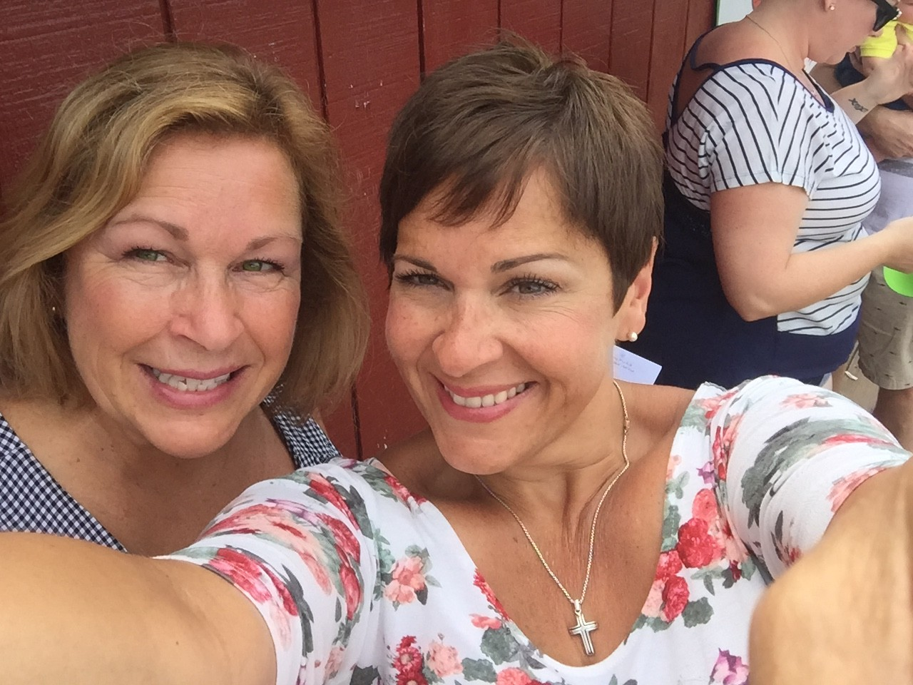 Lou and Sandy snapping a selfie at an outdoor music festival.