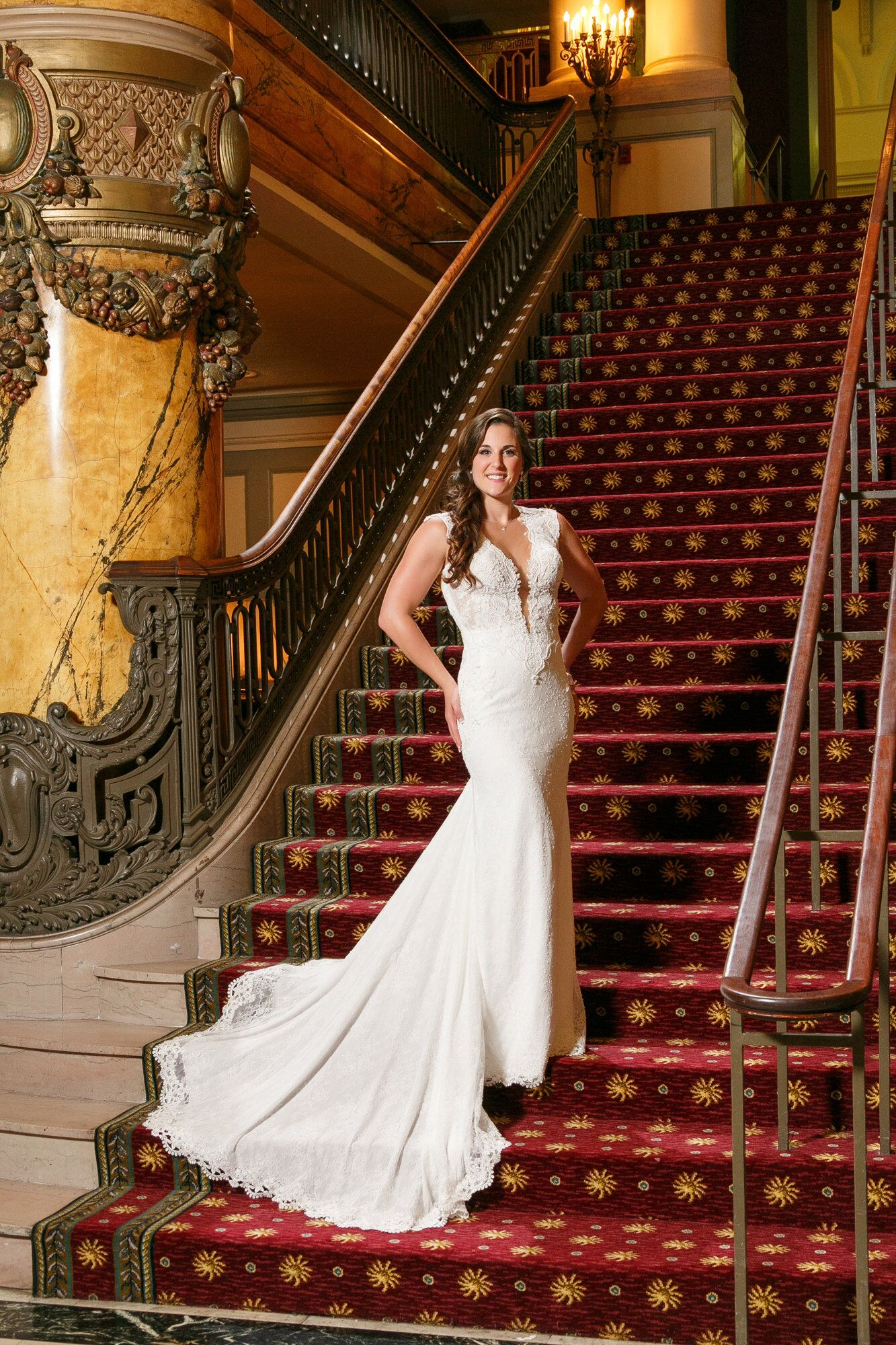 amanda posed on the jefferson hotel staircase