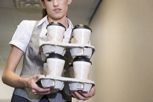 intern carrying a bunch of coffee