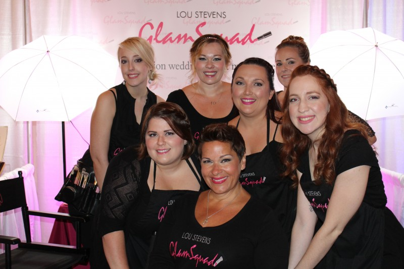 """Lou poses with some of her """"glammies"""" at a recent bridal show."""