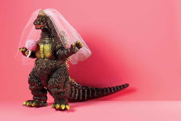 dinosaur figurine wearing a brides veil